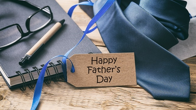 Happy Father's day. Blue tie and tag, office desk background, copy space